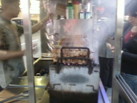 street vendor grilling meats