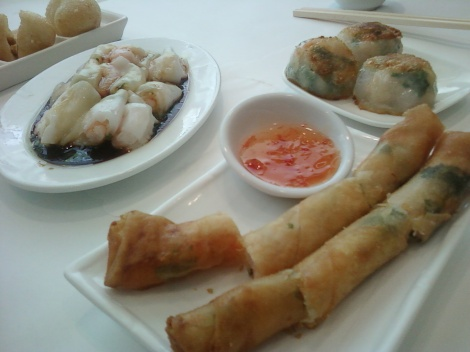 various plates of dim sum