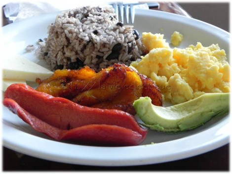 Typical breakfast = rice & beans, eggs, sausage (hot dog), plaintains, avocado.